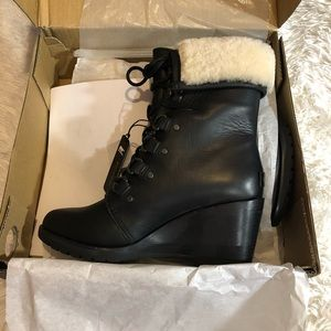 New sorel after hours shearling boots